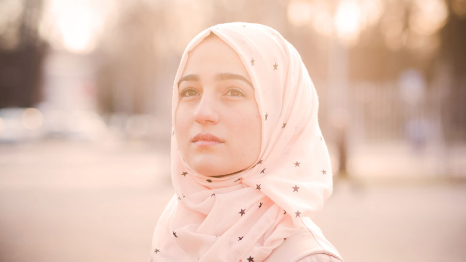 Woman in headscarf outside