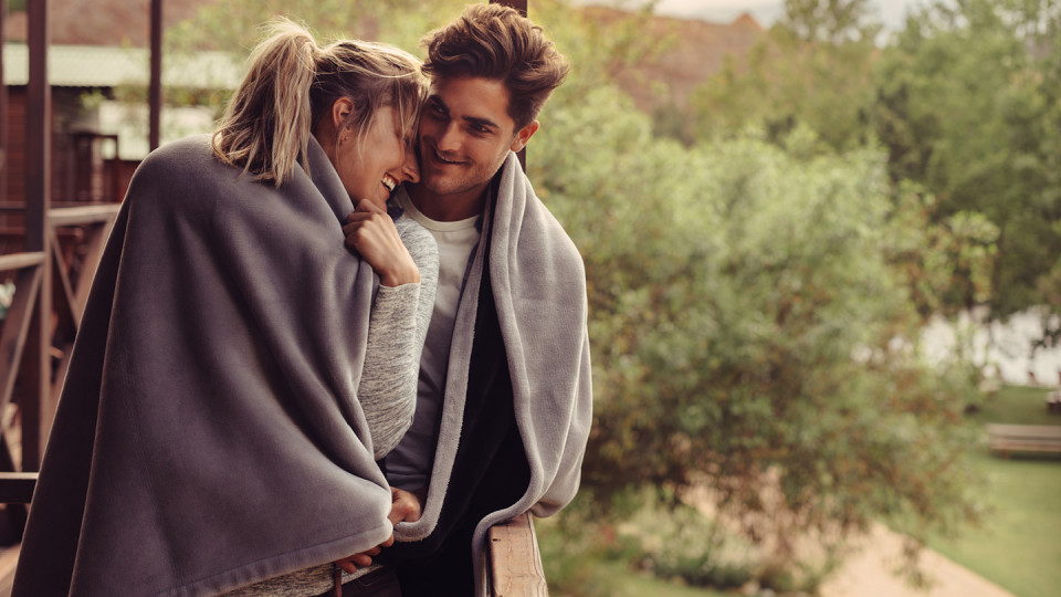 Young couple in blankets outside